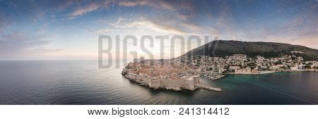 Panoramic aerial view of the old walled city or town of Dubrovnik, Croatia with blue cloudy skies and mediterranean sea