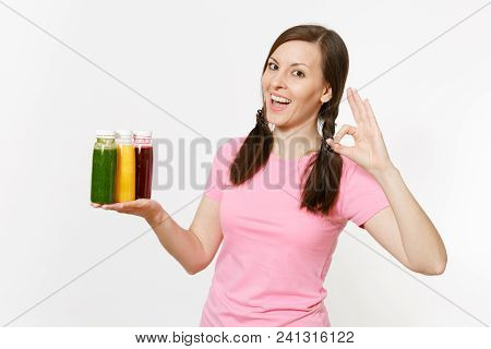 Fun Woman Holds Row Of Green, Red, Yellow Detox Smoothies In Bottles Isolated On White Background. P