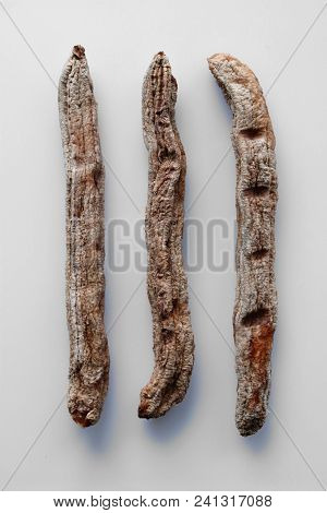 3 Hand Made Dried Banana Isolated On White Background.