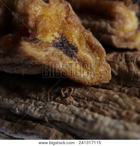 Dried Banana Section On Stack Of Dried Bananas. Macro Closeup.