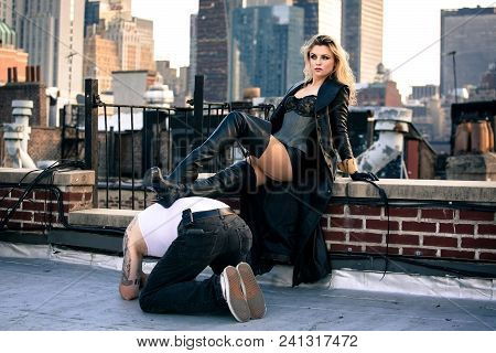Young Sexy Dominatrix Taking Control Of Strong Man