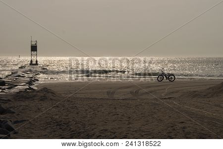 A Beach Bicycle Is Ready For A Morning Ride Along The Atlantic Ocean Near The Delaware Seashore Stat