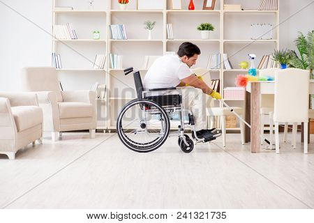 Disabled man cleaning floor at home