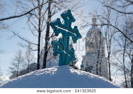 Orthodox Cross In The Street In Winter In The Daytime.
