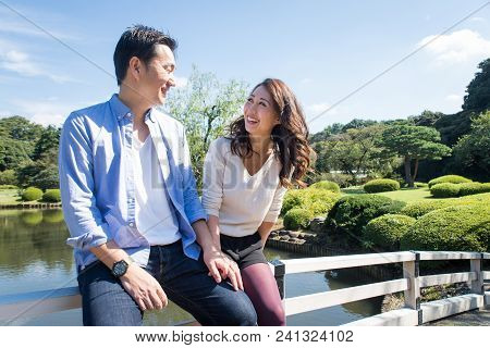Beautiful Asian Couple Dating In A Park