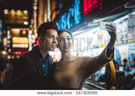 Happy Japanese Couple Dating Outdoors In Tokyo