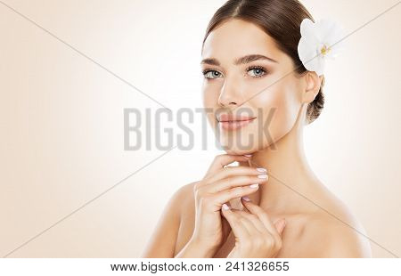 Woman Beauty, Face Skin Care And Natural Make Up, Girl With Orchid Flower In Straight Hair, Beautifu