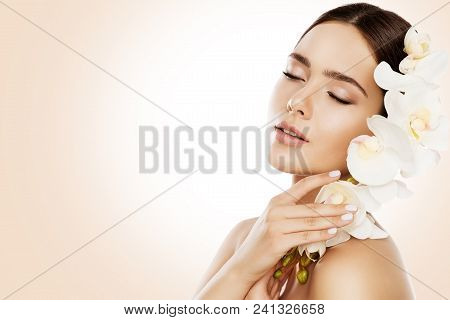 Woman Beauty, Face Skin Care And Make Up, Girl Orchid Flower In Straight Hair, Beautiful Makeup And