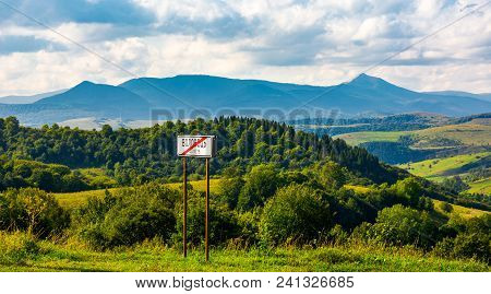 Road Sign On The Hillside. Mountain Ridge  With Pikui Peak In The Distance. Carpathian Travel Destin