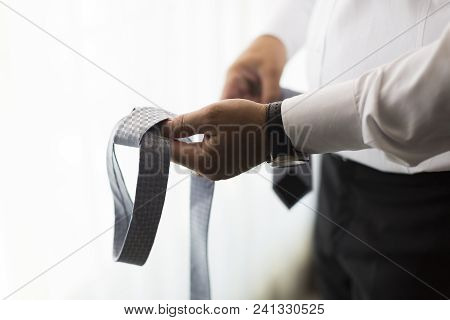 People, Business, Fashion And Clothing Concept - Close Up Of Man In Shirt Dressing Up And Adjusting