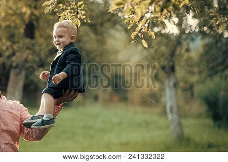 Happy Kid Having Fun. Cute Toddler Smile In Suit, Shirts, Sneakers Under Tree, Fashion. Small Boy Si