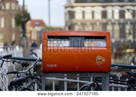 Leiden, Netherlands, 23 September, 2017: Image Of The Orange Mailbox Owned By The Post Nl, Holland P