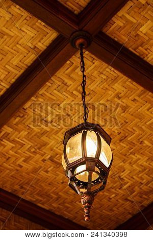 Classic Hanging Lamp On Bamboo And Wood Ceiling