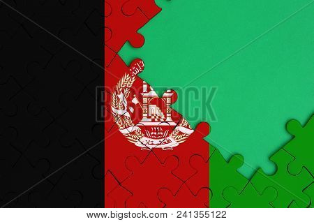 Afghanistan Flag Is Depicted On A Completed Jigsaw Puzzle With Free Green Copy Space On The Right Si