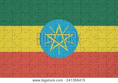 Ethiopia Flag  Is Depicted On A Folded Puzzle