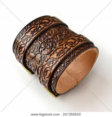 Aged Brown Leather Bracelet Filled With Embossed Skulls - Top View
