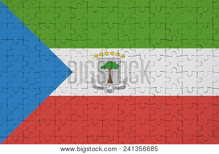 Equatorial Guinea Flag  Is Depicted On A Folded Puzzle