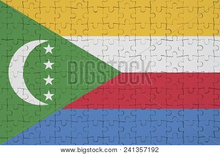 Comoros Flag  Is Depicted On A Folded Puzzle
