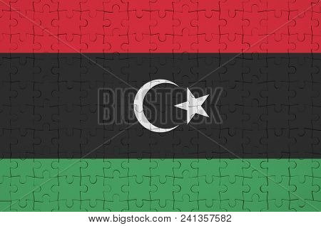 Libya Flag  Is Depicted On A Folded Puzzle