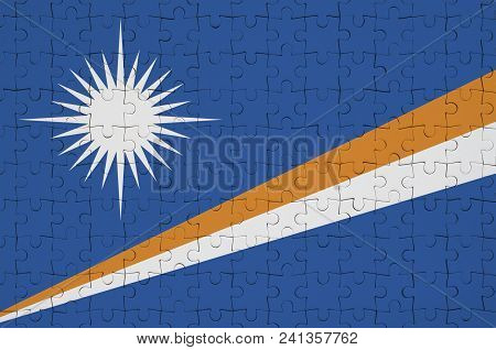 Marshall Islands Flag  Is Depicted On A Folded Puzzle