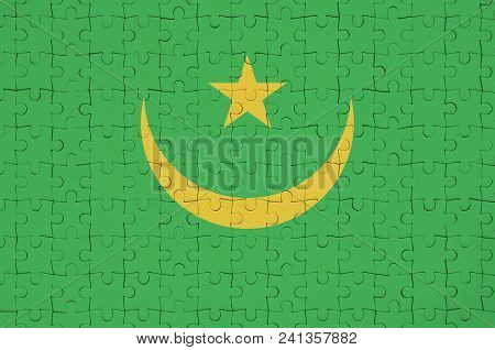 Mauritania Flag  Is Depicted On A Folded Puzzle