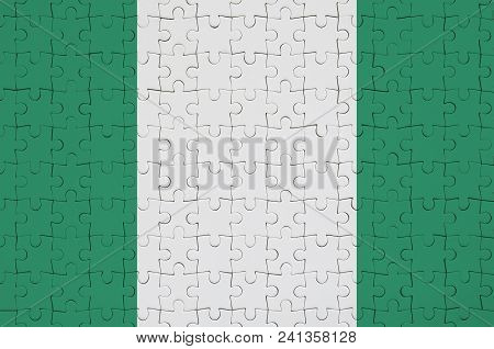 Nigeria Flag  Is Depicted On A Folded Puzzle