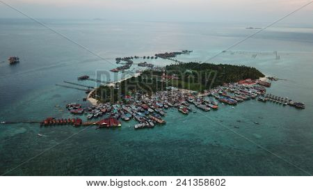Mabul Island, Malaysia. Islands like this are endangered by climate change and rising sea levels
