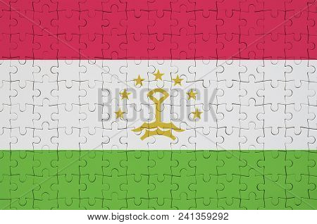Tajikistan Flag  Is Depicted On A Folded Puzzle