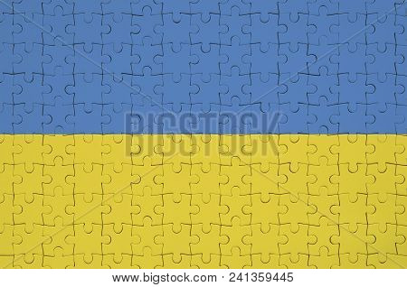 Ukraine Flag  Is Depicted On A Folded Puzzle