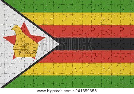Zimbabwe Flag  Is Depicted On A Folded Puzzle