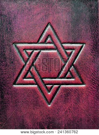 The Star Of David, Embossed To The Aged Red Leather