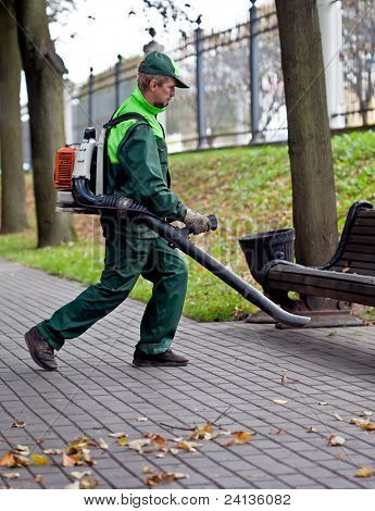 Landscaper cleaning the track by Leaf Blower
