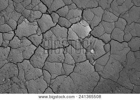 Details Of The Ground The Cracks In The Soil. Due To The Lack Of Moisture In The Soil, The Character