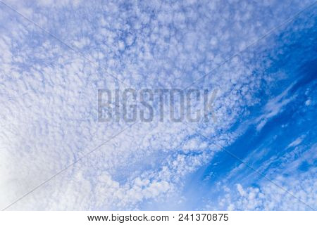 Beautiful Cirrus Clouds On A Bright Blue Sky In Sunny Light. Cloudy Background. Universal Template F