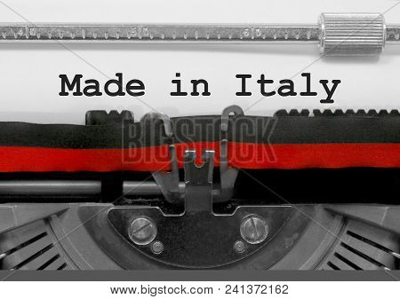 Made In Italy Text Written By An Old Typewriter On White Sheet