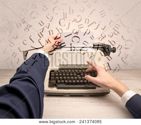 First person perspective elegant hand writing on typewriter with flying letters concept