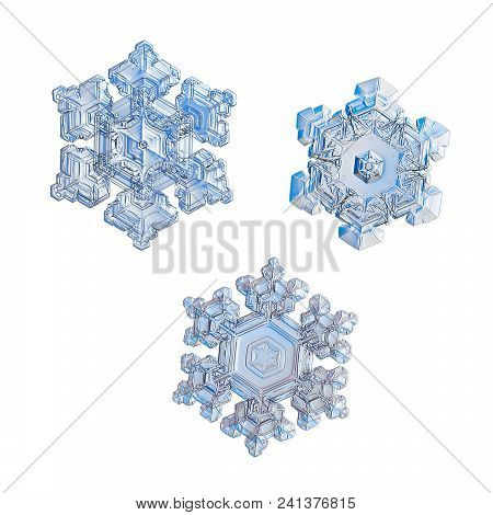 Three Snowflakes Isolated On White Background. Macro Photo Of Real Snow Crystals: Small Star Plates