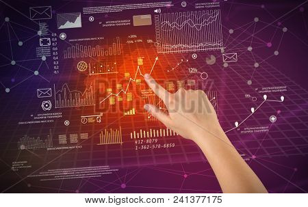 Female hand touching charts and graphs on a red and purple background