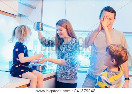 Family, Children, Hapiness And People Concept. Happy Family With Children Preparing Pancakes In The