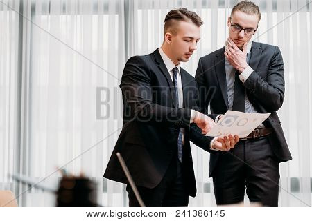 Business Documents Review. Man Pointing At Some Important Data With A Finger. Statistics Papers Anal