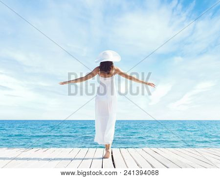 Young, Beautiful And Healthy Girl On Wooden Pier At Summer. Vacation, Resort, Traveling And Tourism