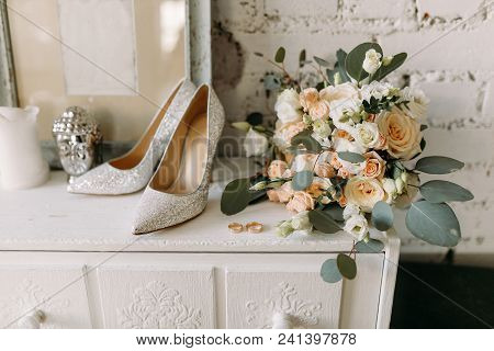 Wedding Shoes And Wedding Paraphernalia, Wedding Gold Rings, Wedding Bouquet On The Table