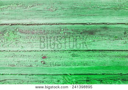 Texture Background Of Wooden Planks Covered With Old Peeling Paint Of Green Color. Wooden Texture Su