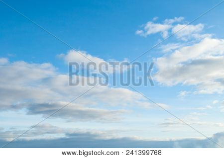 Blue Sky Landscape With White Evening Clouds In The Vast Sky. Sky Landscape Scene. Sky Landscape Of