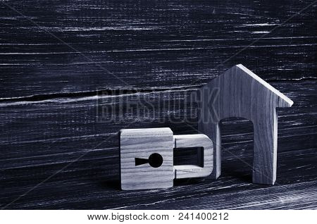 Wooden House With A Padlock. House With A Lock. Security And Safety, Collateral, Loan For A Mortgage