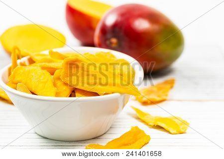 Homemade Dried Mango Fruit Background. Selective Focus.