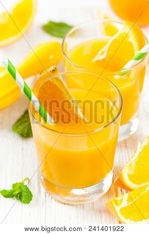 Orange Juice On White Wooden Background. Selective Focus.