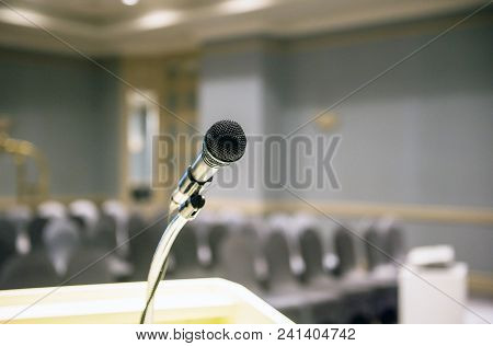 Microphone On Blurred In Seminar Room Or Conference Hall Background