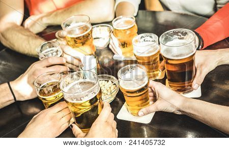 Friends Hands Drinking Beer At Brewery Pub Restaurant - Friendship Concept With Young People Enjoyin