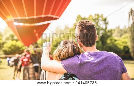 Happy Couple In Love On Honeymoon Excursion Waiting For Hot Air Balloon Ride - Summer Travel Concept